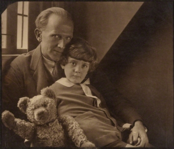 A.A. Milne poses with his son, Christopher Robin Milne and a stuffed Winnie-the-Pooh/Photo by Howard Coster, 1926