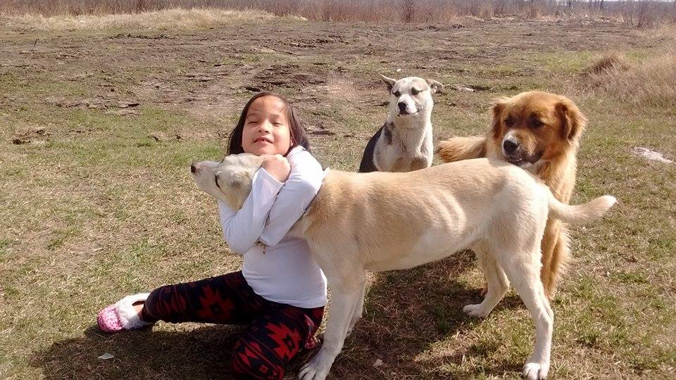 Who says dogs don't love hugs? / Submitted by family
