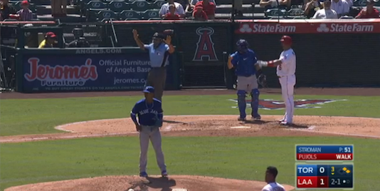 Umpire waves off play while a swarm of bees take over the field in Anaheim/MLB