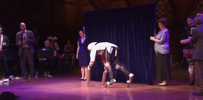 Thomas Thwaites on stage at Harvard University to collect his Ig Nobel. Improbable Research/YouTube